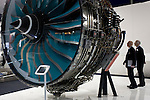 A full-size Trent jet engine is admired by delegates visiting British Rolls-Royce manufacturer's exhibition stand at the Farnborough Air Show, England. Rolls-Royce Trent is the name given to a family of three-spool, high bypass turbofan aircraft engines manufactured by Rolls-Royce plc. The engine is named after the River Trent in the Midlands of England. The civil aerospace business is a major manufacturer of aero engines for all sectors of the airliner and corporate jet market. Rolls-Royce powers more than 30 types of commercial aircraft and has almost 13,000 engines in service around the world.