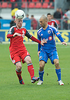 20 October 2012: Toronto FC defender Richard Eckersley #27 and Montreal Impact forward Marco Di Vaio #9 in action during an MLS game between the Montreal Impact and Toronto FC at BMO Field in Toronto, Ontario Canada. .The ended in a 0-0 draw..