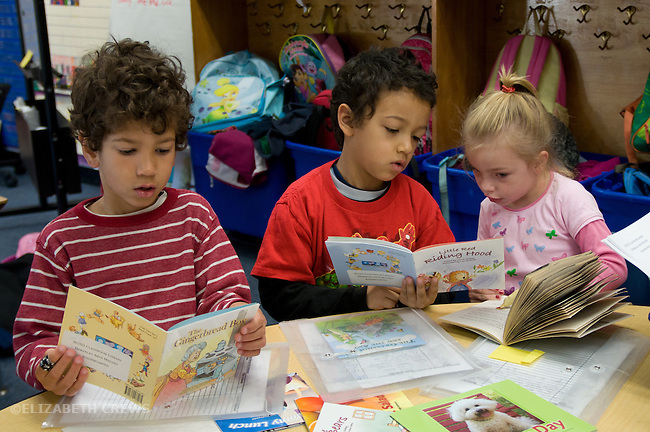 Berkeley Ca Kindergarten students practicing their reading together and independently