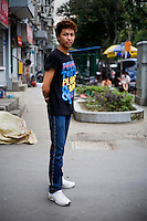 Kanglu, a hairstylist, age 23, poses for a portrait in Nanjing. Response to 'What does China mean to you?': 'Extremely good.'  Response to 'What is China's role in the future?': 'China will get even better in the future. I hope that more and more foreign friends will come to China. All of us here (in China) welcome you!'