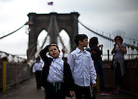 Children walk through the Brooklyn Bridge while it remains under maintenance one day before its 130th anniversary in New York,  May 23, 2013, Photo by Eduardo Munoz Alvarez / VIEWpress.