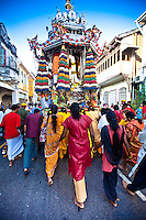Women following the Siver Chariot on the route to the Nattukotai Chettiar Temple.