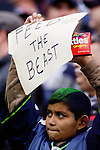 A Seattle Seahawks fan holds Skittles and a sign for running back Marshawn Lynch in the Seahawks game against the San Francisco 49ers at CenturyLink Field in Seattle, Washington on December 24, 2011.  The 49ers came from behind to beat the Seahawks 19-17. ©2011 Jim Bryant Photo. All Rights Reserved.