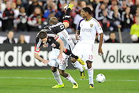 Chris Pontius of D.C. United goes against Real Salt Lake Khari Stephenson. D.C. United defeated Real Salt Lake 1-0 in their home opener, at RFK Stadium, Saturday March 9,2013.