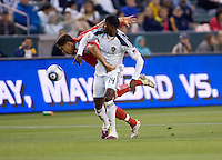 LA Galaxy forward Edson Buddle (14) battles Toronto FC defender Adrian Cann (12) for the ball. The LA Galaxy and Toronto FC played to a 0-0 draw at Home Depot Center stadium in Carson, California on Saturday May 15, 2010.  .