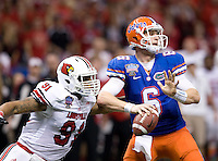 Louisville defensive end Marcus Smith tries to sack Florida quarterback Jeff Driskel during the 79th Sugar Bowl game at Mercedes-Benz Superdome in New Orleans, Louisiana on January 2nd, 2013.   Louisville Cardinals defeated Florida Gators, 33-23.
