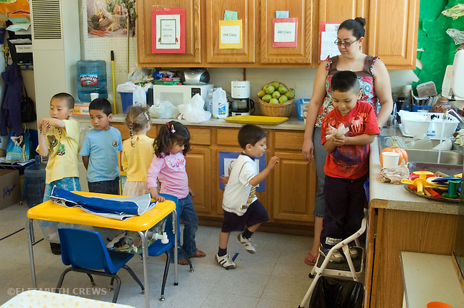 Berkeley CA  Washing up for snack time at bilingual Spanish-English preschool