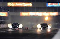 May 18, 2012; Topeka, KS, USA: NHRA funny car driver Alexis DeJoria (right) races alongside John Force during qualifying for the Summer Nationals at Heartland Park Topeka. Mandatory Credit: Mark J. Rebilas-