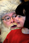 Santa asks kids what they would like for Christmas while spending some time at Sacramento Elementary School for the Santa breakfast.
