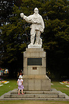 Young girl contemplating a statue of Robert Falcon Scott, Christchurch, New Zealand