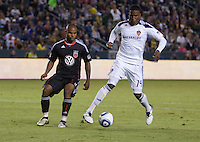 Galaxy forward Edson Buddle back heals a ball while being marked by DC United defender Julius James. The LA Galaxy defeated DC United 2-1at Home Depot Center stadium in Carson, California on Saturday September 18, 2010.