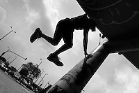 Steven Mantilla, a freerunner from Tamashikaze team, performs parkour moves on the footbridge column during a free running training exercise in Bogotá, Colombia, 13 March 2016. Parkour, originally developed in France during the late 1980s from military training, is a physical activity, focused on the art of movement and overcoming obstacles in a strictly urban environment. Practitioners of parkour employ running, climbing, jumping, rolling and other movements to pass through any urban area the most efficient way possible.