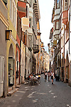 Via dei Portici, the pedestrian shopping street lined with Romanesque-style houses and arcades