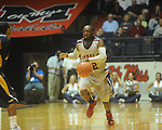 "Ole Miss guard Chris Warren (12)  dribbles at the C.M. ""Tad"" Smith Coliseum in Oxford, Miss. on Wednesday, November 17, 2010."