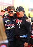 Feb 26, 2017; Chandler, AZ, USA; NHRA top fuel driver Troy Coughlin Jr (left) and Scott Palmer during the Arizona Nationals at Wild Horse Pass Motorsports Park. Mandatory Credit: Mark J. Rebilas-USA TODAY Sports