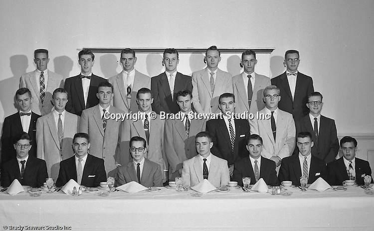 Pittsburgh PA:  View of the Caddies receiving college scholarships from the Western Pennsylvania Golf Association's Caddie Welfare Foundation for year 1955.  The Foundation was managed by Fidelity Trust Company and scholarships are agreed upon by the WPGA executive committee. This dinner was held at the Longue Vue Country Club in Penn Hills and the assignment was for Charles K. Robinson. The mission of the WPGA are to sanction championships, establish handicapping and rate area golf courses.