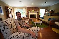 Northwest Arkansas Democrat Gazette/SPENCER TIREY<br /> Clint Shnekloth in the living room of his home in Fayetteville Arkansas Friday Sept. 18, 2105.