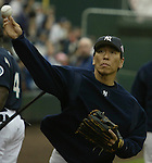 New York Yankees' Hideli Matsui warms up before their game against the Seattle Mariners in Seattle, Washington. Jim Bryant @2010 ALL RIGHTS RESERVED.
