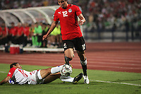 Egypt's Islam Ramadan (12) takes the ball away from Costa Rica's Cristian Gamboa (12) during the FIFA Under 20 World Cup Round of 16 match between Egypt and Costa Rica at the Cairo International Stadium on October 06, 2009 in Cairo, Egypt.
