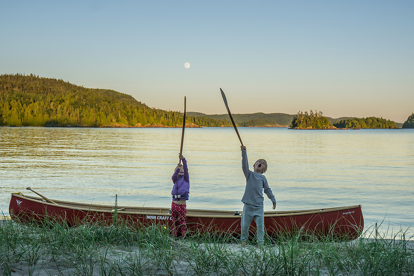 A full moon rises over Warp Bay while canoe camping at Lake Superior Provincial Park, Ontario, Canada.