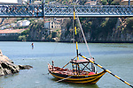 Kids jumping into the Douro River from the Don Luis iron bridge in Porto, Portugal.