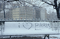 sign in the snow near Notre Dame, &quot;I love Paris&quot; - photograph by Owen Franken