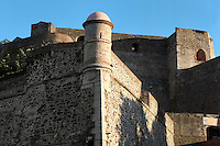 Watchtower and walls, Chateau Royal, Collioure, France. Much of the castle was built in the 13th and 14th centuries by the Dukes of Roussillon and the Knights Templar. In the 16th century Collioure was under Spanish control and Philip II modernised and reinforced the castle. It was taken by the French in 1659 after which the bastions were built by Vauban (1633-1707). Picture by Manuel Cohen.
