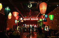 Holly and John's wedding reception guests enjoy the colorful lanterns and music at the Georgetown Ballroom in Seattle's Georgetown neighborhood. (Photo by Dan DeLong/Red Box Pictures)