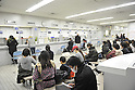 March 17, 2011, Tokyo, Japan - Japanese people wait their turn at the Passport Office in Shinjuku, Tokyo. (Photo by Atsushi Tomura/AFLO)
