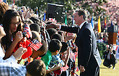 British Prime Minister David Cameron greets people during an official arrival ceremony at the South Lawn of the White House March 14, 2012 in Washington, DC. Prime Minister Cameron is on a three-day visit in the U.S. and he is expected to have talks with President Obama on the situations in Afghanistan, Syria and Iran. .Credit: Mark Wilson - Pool via CNP