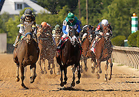 May 19, 2012 Awesomemundo (left), Mike Smith up, wins the  20th running of the Allaire Dupont Distaff Stakes  at Pimlico Race Course in Baltimore, Maryland. Bob Baffert trains her. Love and Pride (#8) with John Velazquez, is second. photo by Joan Fairman Kanes