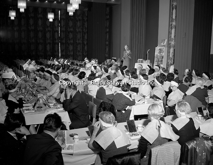 Pittsburgh PA:  On location photograpy at Pittsburgh's William Penn Hotel for local advertising agency.  Men and women participating in the new Revlon Beauty Seminars - 1956