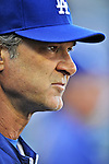 19 September 2012: Los Angeles Dodgers Manager Don Mattingly watches play from the dugout during a game against the Washington Nationals at Nationals Park in Washington, DC. The Nationals defeated the Dodgers 3-1 in the first game of their double-header. Mandatory Credit: Ed Wolfstein Photo