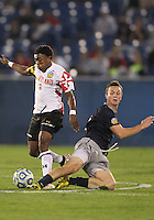 HOOVER, AL - DECEMBER 07, 2012:  Christiano Francois (3) of the University of Maryland avoids a tackle from Joey Dillon (4) of Georgetown University during an NCAA 2012 Men's College Cup semi-final match, at Regents Park, in Hoover , AL, on Friday, December 07, 2012. The game ended in a 4-4 tie, after overtime Georgetown won on penalty kicks.