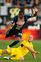 Sheanon Williams (25) of the Philadelphia Union jumps over the tackle of Eric Gehrig (16) of the Columbus Crew. The Philadelphia Union defeated the Columbus Crew 3-0 during a Major League Soccer (MLS) match at PPL Park in Chester, PA, on June 5, 2013.