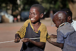 Boys play tug of war in the Makpandu refugee camp in Southern Sudan, 44 km north of Yambio, where more that 4,000 people took refuge in late 2008 when the Lord's Resistance Army attacked their communities inside the Democratic Republic of the Congo. Attacks by the LRA inside Southern Sudan and in the neighboring DRC and Central African Republic have displaced tens of thousands of people, and many worry the attacks will increase as the government in Khartoum uses the LRA to destabilize Southern Sudan, where people are scheduled to vote on independence in January 2011. Catholic pastoral workers have accompanied the people of this camp from the beginning.