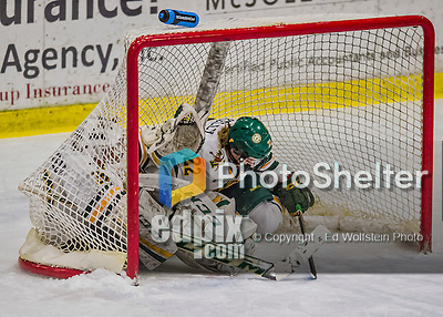 13 February 2015: University of Vermont Catamount Forward Sarah Kelly, a Sophomore from Vestal, NY, slides into the net with goaltender Madison Litchfield in the  first period against the University of New Hampshire Wildcats at Gutterson Fieldhouse in Burlington, Vermont. The Lady Catamounts fell to the visiting Wildcats 4-2 in the first game of their weekend Hockey East series. Mandatory Credit: Ed Wolfstein Photo *** RAW (NEF) Image File Available ***