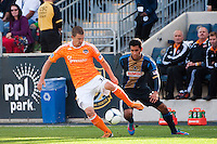 Bobby Boswell (32) of the Houston Dynamo is marked by Josue Martinez (17) of the Philadelphia Union. The Philadelphia Union defeated the Houston Dynamo 3-1 during a Major League Soccer (MLS) match at PPL Park in Chester, PA, on September 23, 2012.