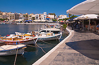 Boats and restaurants on lake Voulismeni in Agios Nikolaos, Crete