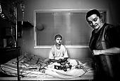 Wroclaw 02.02.2007 Poland.<br /> Ula Nabozna,10 with his mom. Ula bleeds from mouth often so she needs to be under directly observation.<br /> Clinical Hospital, oncology and haematology departmend. This is one of the important Haematologic Hospital in all over Poland, however hospital board stopped to discharge a rising debt. In this connection authorities must close hospital, but goverment had no idea what should do with terminaly ill children.<br /> (Photo: Adam Lach / Napo Images)<br /> <br /> Ula Nabozna ( 10 ) z mama. Ula czesto krwawi z ust dlatego musi byc pod stala obserwacja lekarzy.<br /> Akedemicki Szpital Kliniczny, oddzial onkologii i hematologii. Temu jednemu z najwazniejszych w Polsce osrodkowi szpitalnemu grozi zamkniecie w powodu dlugow, ktore niezaleznie od wplat NFZ-tu regularnie sciaga komornik. Z calej Polski ludzie charytatywnie wplacaja pieniadze by uratowac szpital i los dzieci dla ktorych to miejsce jest jedynym ratunkiem.
