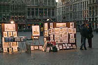 A vendor setup to sell art prints to tourists in Grand Place, Brussels