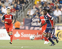 New England Revolution substitute midfielder Shalrie Joseph (21) dribbles at midfield. In a Major League Soccer (MLS) match, Toronto FC defeated New England Revolution, 1-0, at Gillette Stadium on July 14, 2012.