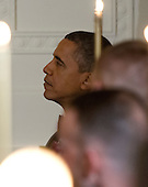 United States President Barack Obama listens to U.S. Vice President Biden's remarks as he and first lady Michelle Obama host a dinner to honor our Armed Forces who served in Operation Iraqi Freedom and Operation New Dawn and to honor their families in the East Room of the White House in Washington, D.C. on Wednesday, February 29, 2012..Credit: Ron Sachs / Pool via CNP