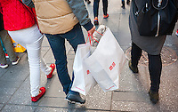 Shoppers in New York holding Uniqlo shopping bags with their various purchases on Tuesday, October 25, 2016. Consumer confidence is reported to have dropped in October attributed in part to the U.S. election. (©Richard B. Levine)