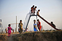 Children play at a playground in the Swabi Refugee camp. The camp is run by Red Cross/Red Crescent (ICRC), and currently houses around 18,000 refugees. The Pakistani government began an offensive against the Taliban in the Swat Valley in April 2009, which led to a major humanitarian crisis. Up to two million civilians were estimated to have been displaced by the fighting.