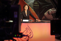 Newsreader Ghida Fakhry on air for news channel Al Jazeera English in Doha.
