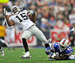 21 September 2008: Oakland Raiders' wide receiver Johnnie Lee Higgins is tackled by Buffalo Bills defensive back Bryan Scott during a game against the Buffalo Bills at Ralph Wilson Stadium in Orchard Park, NY. The Bills rallied for 10 unanswered points in the 4th quarter to defeat the Raiders 24-23...Mandatory Photo Credit: Ed Wolfstein Photo