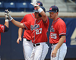 Mississippi's Taylor Hashman (27) scores on Mississippi's Alex Yarbrough (2) triple vs. St. John's during an NCAA Regional game at Davenport Field in Charlottesville, Va. on Sunday, June 6, 2010.
