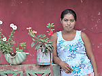 A woman in front of  her home in Las Flores, Ixcan, Guatemala.