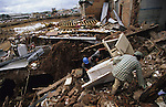 Central America, Honduras, Tegucigalpa. retrieving materials from ruins. Devastation in the aftermath of Hurricane Mitch. High winds and flooding. Retrieving fridges and kitchen equipment. Infrastructure destroyed.
